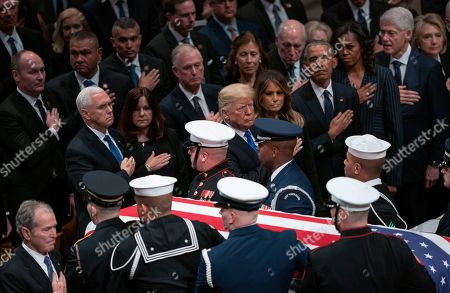 Mike Pence, Karen Pence, Dick Cheney, Dan Quayle, Marilyn Quayle, George W. Bush, Donald Trump, Melania Trump, Rosalynn Carter, Barack Obama, Michelle Obama, Hillare Clinton, Bill Clinton, Jiimmyb Carter. The flag-draped casket of former President George H.W. Bush is carried by a military honor guard past former President George W. Bush, President Donald Trump, first lady Melania Trump, former President Barack Obama, Michelle Obama, former President Bill Clinton, and former Secretary of State Hillary Clinton, at the end of a State Funeral at the National Cathedral, in Washington. In the second row are Vice President Mike Pence, and his wife Karen Pence, former Vice President Dan Quayle, and his wife Marilyn Quayle and former Vice President Dick Cheney