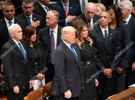 Mike Pence, Karen Pence, Dick Cheney, Dan Quayle, Marilyn Quayle, Donald Trump, Melania Trump, Barack Obama, Michelle Obama, Bill Clinton. President Donald Trump, first lady Melania Trump, former President Barack Obama, Michelle Obama, former President Bill Clinton, stand at the end of a State Funeral for former President George H.W. Bush at the National Cathedral, in Washington. In the second row are Vice President Mike Pence, and his wife Karen Pence, former Vice President Dan Quayle, and his wife Marilyn Quayle and former Vice President Dick Cheney