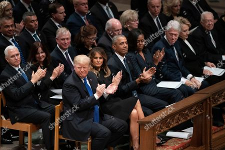 Joe Biden, Jill Biden, Mike Pence, Karen Pence, Dick Cheney, Dan Quayle, Marilyn Quayle, Donald Trump, Melania Trump, Barack Obama, Michelle Obama, Bill Clinton. President Donald Trump, first lady Melania Trump, former President Barack Obama, Michelle Obama, former President Bill Clinton, former Secretary of State Hillary Clinton, former President Jimmy Carter, former applaud during a State Funeral for former President George H.W. Bush at the National Cathedral, in Washington. In the second row are Vice President Mike Pence, and his wife Karen Pence, former Vice President Dan Quayle, and his wife Marilyn Quayle and former Vice President Dick Cheney and his wife Lynn Cheney, former Vice President Joe Biden and his wife Jill Biden