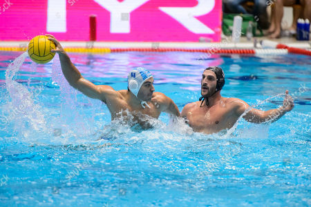 Stock Image of Marco Avramovic of Eger (L) in action against Valentino Gallo of Brescia during the men?s water polo Champions League match ZF-Eger of Hungary vs AN Brescia of Italy, in Eger, 127 kms northeast of Hungary, 05 December 2018.