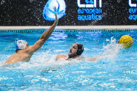 Stock Photo of Marco Avramovic of Eger (L) in action against Valentino Gallo of Brescia during the men?s water polo Champions League match ZF-Eger of Hungary vs AN Brescia of Italy, in Eger, 127 kms northeast of Hungary, 05 December 2018.