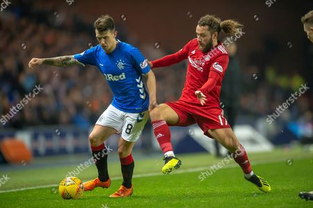 Stevie May (#17) of Aberdeen FC tackles Ryan Jack (#8) of Rangers FC during the Ladbrokes Scottish Premiership match between Rangers and Aberdeen at Ibrox, Glasgow