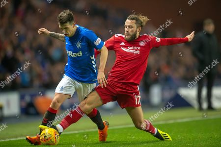 Stock Photo of Stevie May (#17) of Aberdeen FC tackles Ryan Jack (#8) of Rangers FC during the Ladbrokes Scottish Premiership match between Rangers and Aberdeen at Ibrox, Glasgow