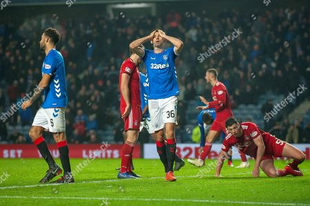 Gareth McAuley (#36) of Rangers FC has his head in his hands after missing a header in the last moments of the Ladbrokes Scottish Premiership match between Rangers and Aberdeen at Ibrox, Glasgow