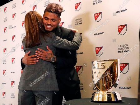 Atlanta United soccer player Josef Martinez is embraced by Angie Blank wife of team owner Arthur Blank after it was announced he had won the Landon Donovan MLS MVP award, in Atlanta
