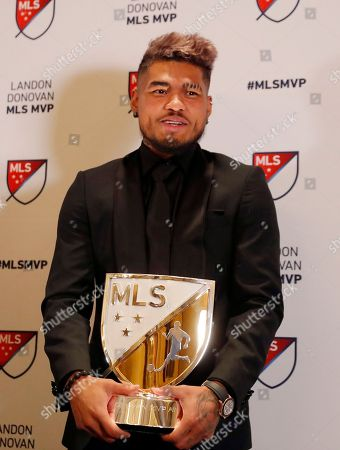 Atlanta United soccer player Josef Martinez poses with the trophy after he was presented with the Landon Donovan MLS MVP award, in Atlanta
