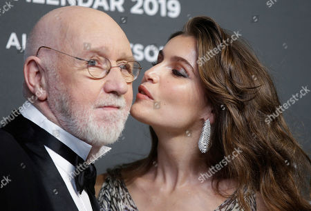 Actress Laetitia Casta kisses photographer Albert Watson as they arrive on the occasion of the 2019 Pirelli Calendar event in Milan, Italy