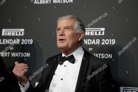World champion motorcycle racer Giacomo Agostini gestures on the red carpet on the occasion of the 2019 Pirelli Calendar event in Milan, Italy