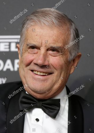 World champion motorcycle racer Giacomo Agostini smiles on the red carpet on the occasion of the 2019 Pirelli Calendar event in Milan, Italy