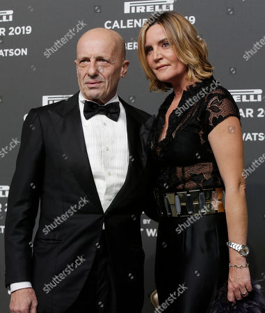 Stock Picture of Italian journalist Alessandro Sallusti is flanked by his partner Patrizia D'Asburgo Lorena on the red carpet on the occasion of the 2019 Pirelli Calendar event in Milan, Italy