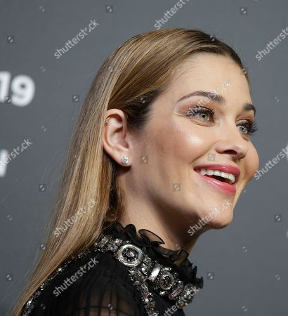Ana Beatriz Barros poses on the red carpet on the occasion of the 2019 Pirelli Calendar event in Milan, Italy