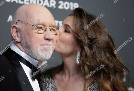 Actress Laetitia Casta kisses photographer Albert Watson on the red carpet on the occasion of the 2019 Pirelli Calendar event in Milan, Italy