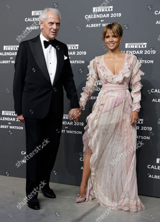 U.S. actress Halle Berryis flanked by Pirelli CEO Marco Tronchetti Provera on the red carpet on the occasion of the 2019 Pirelli Calendar event in Milan, Italy
