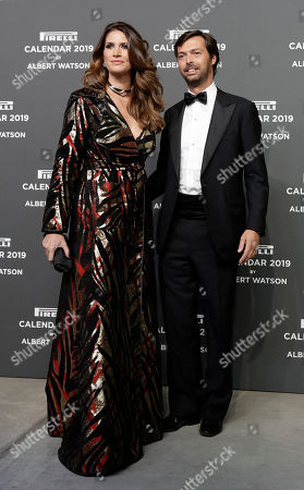 Giovanni Tronchetti Provera is flanked by his partner Nicole Moellhausen on the red carpet on the occasion of the 2019 Pirelli Calendar event in Milan, Italy
