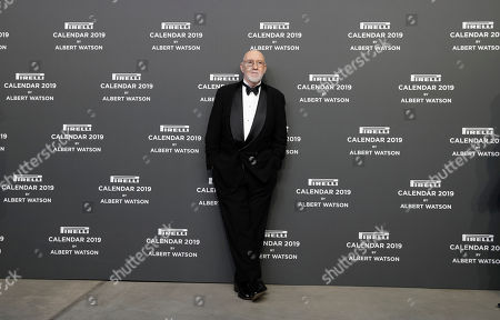 Photographer Albert Watson poses on the red carpet on the occasion of the 2019 Pirelli Calendar event in Milan, Italy