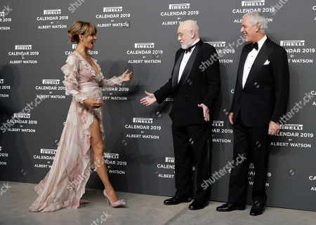 U.S. actress Halle Berry, left is flanked by photographer Albert Watson, center and Pirelli CEO Marco Tronchetti Provera on the red carpet on the occasion of the 2019 Pirelli Calendar event in Milan, Italy