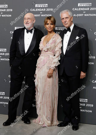 U.S. actress Halle Berry, center, is flanked by photographer Albert Watson, left, and Pirelli CEO Marco Tronchetti Provera on the red carpet on the occasion of the 2019 Pirelli Calendar event in Milan, Italy