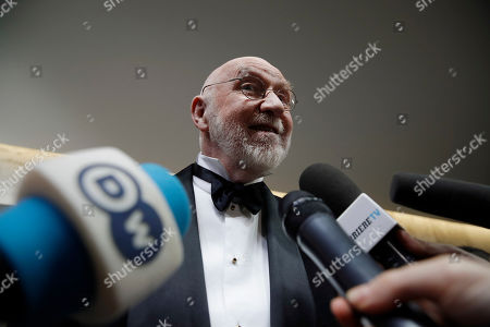 Photographer Albert Watson answers to reporters on the red carpet on the occasion of the 2019 Pirelli Calendar event in Milan, Italy