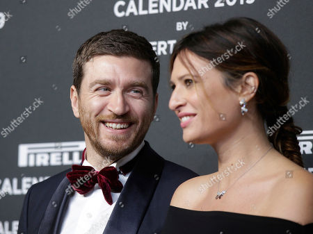 Stock Photo of Alessandro Roja and Claudia Ranieri stand on the red carpet on the occasion of the 2019 Pirelli Calendar event in Milan, Italy