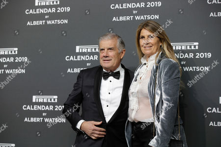 World champion motorcycle racer Giacomo Agostini is flanked by is wife Maria on the red carpet on the occasion of the 2019 Pirelli Calendar event in Milan, Italy