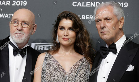Model Laetitia Casta poses flanked by photographer Albert Watson and Marco Tronchetti Provera on the red carpet at the unveiling 2019 Pirelli Calendar event in Milan, Italy