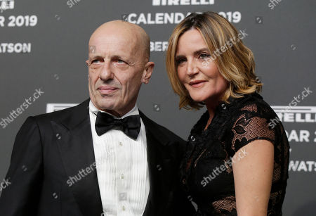 Italian journalist Alessandro Sallusti is flanked by his partner Patrizia D'Asburgo Lorena on the red carpet on the occasion of the 2019 Pirelli Calendar event in Milan, Italy