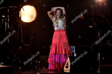 Kasey Chambers and Paul Kelly (back, R) perform on stage during the 32nd ARIA Awards at The Star in Sydney, New South Wales, Australia, 28 November 2018.
