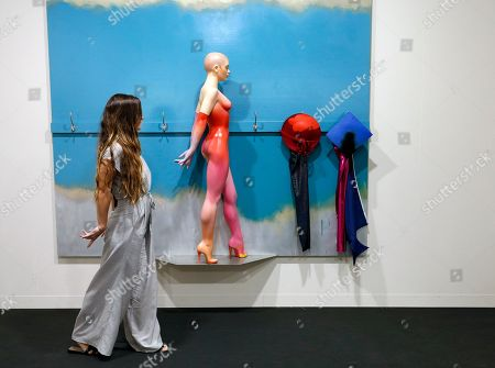 An Art Basel patron poses like a sculpture by artist Allen Jones during Art Basel in Miami, Florida, USA, 05 December 2018. Art Basel represents over 250 art galleries onsite at the Miami Beach Convention Center and is considered one of the world's largest art festivals with art events throughout the city.