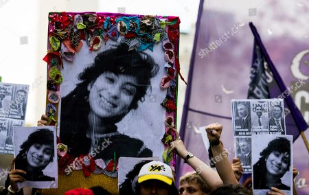 Pictures of gender violence victim Lucia Perez, 16, are held up during a protest in Buenos Aires, Argentina, . Argentine feminist groups and labor unions are protesting the court ruling that acquitted two men accused of sexually abusing and killing the teen. The ruling said that the girl had consensual sex with one of the men and that she died of an overdose