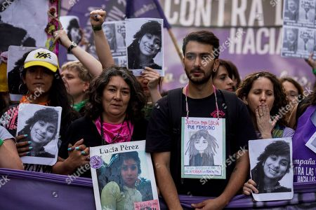 Marta Perez, front left, and Matias Perez, front right, the mother and brother of gender violence victim Lucia Perez, join a protest against gender violence in Buenos Aires, Argentina, . Argentine feminist groups and labor unions are protesting a court ruling that acquitted two men accused of sexually abusing and killing a 16-year-old girl