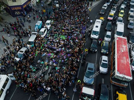 Women lie on 9 de Julio Avenue during a protest against gender violence in Buenos Aires, Argentina, . Argentine feminist groups and labor unions are protesting a court ruling that acquitted two men accused of sexually abusing and killing a 16-year-old Lucia Perez