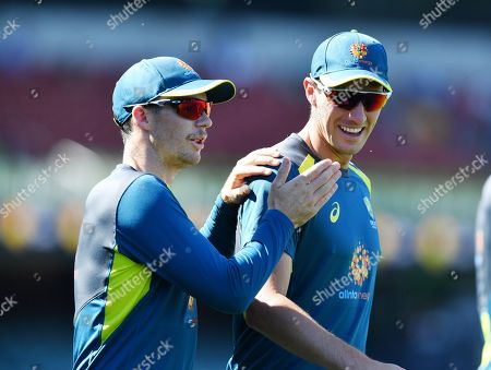 Peter Handscomb and Patrick Cummins of Australia speak during day one of the first Test match between Australia and India at the Adelaide Oval in Adelaide, Australia, 06 December 2018.