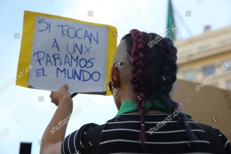 A woman holds a banner with the message 'If one is touched, we stop the world' during a protest against the acquittal men, in the Lucia Perez case, in Buenos Aires, Argentina, 05 December 2018. A court in the coastal city of Mar del Plata recently ruled that the men accused of sexually abusing and killing Lucia Perez in 2016 were not guilty, which lead to an outcry across the country.