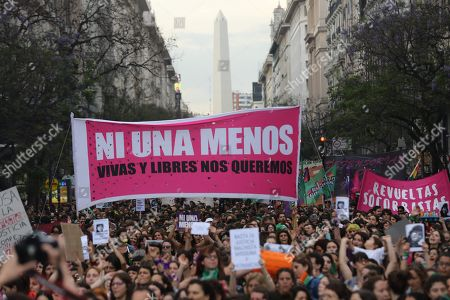 People march along a street during a protest against the acquittal men, in the Lucia Perez case, in Buenos Aires, Argentina, 05 December 2018. A court in the coastal city of Mar del Plata recently ruled that the men accused of sexually abusing and killing Lucia Perez in 2016 were not guilty, which lead to an outcry across the country.