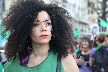 A woman participates in a march along a street during a protest against the acquittal men, in the Lucia Perez case, in Buenos Aires, Argentina, 05 December 2018. A court in the coastal city of Mar del Plata recently ruled that the men accused of sexually abusing and killing Lucia Perez in 2016 were not guilty, which lead to an outcry across the country.