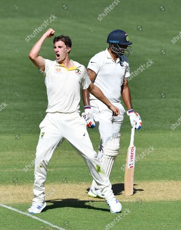 Patrick Cummins (L) of Australia reacts sfter the dismissal of Ravichandran Ashwin of India during day one of the first Test match between Australia and India at the Adelaide Oval in Adelaide, Australia, 06 December 2018.