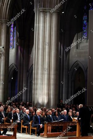 From left, President Donald Trump, first lady Melania Trump, former President Barack Obama, Michelle Obama, former President Bill Clinton, former Secretary of State Hillary Clinton, and former President Jimmy Carter listen as former Sen. Alan Simpson, R-Wyo., speaks during a State Funeral at the National Cathedral, for former President George H.W. Bush. In the second row are Vice President Mike Pence and Karen Pence.