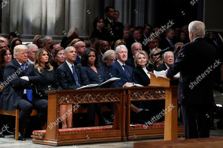 From left, President Donald Trump, first lady Melania Trump, former President Barack Obama, Michelle Obama, former President Bill Clinton, former Secretary of State Hillary Clinton, and former President Jimmy Carter listen as former Canadian Prime Minister Brian Mulroney speaks during a State Funeral at the National Cathedral, for former President George H.W. Bush.