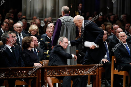 Former President George W. Bush shakes hands with former Sen. Alan Simpson, R-Wyo, after he spoke during the State Funeral for former President George H.W. Bush at the National Cathedral. Watching are Jeb Bush and Laura Bush. At right is Vice President Mike Pence.