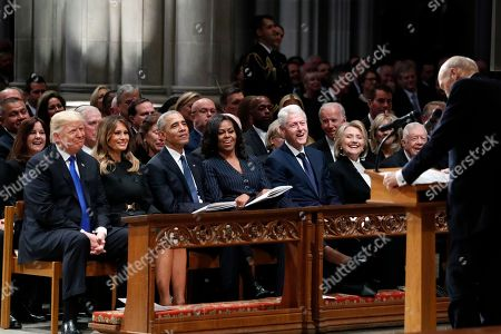 Stock Photo of From left, President Donald Trump, first lady Melania Trump, former President Barack Obama, Michelle Obama, former President Bill Clinton, former Secretary of State Hillary Clinton, and former President Jimmy Carter listen as former Sen. Alan Simpson, R-Wyo., speaks during a State Funeral at the National Cathedral, for former President George H.W. Bush.