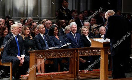 Stock Image of From left, President Donald Trump, first lady Melania Trump, former President Barack Obama, Michelle Obama, former President Bill Clinton, former Secretary of State Hillary Clinton, and former President Jimmy Carter listen as former Sen. Alan Simpson, R-Wyo., speaks during a State Funeral at the National Cathedral, for former President George H.W. Bush. In the second row are Vice President Mike Pence and Karen Pence.