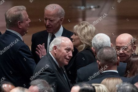 Former Vice President Al Gore, left, speaks with former Vice President Joe Biden, second from left, and his wife Jill Biden, center, as former Vice President Dick Cheney, bottom center, speaks with Commerce Secretary Wilbur Ross, right, before a State Funeral the National Cathedral.