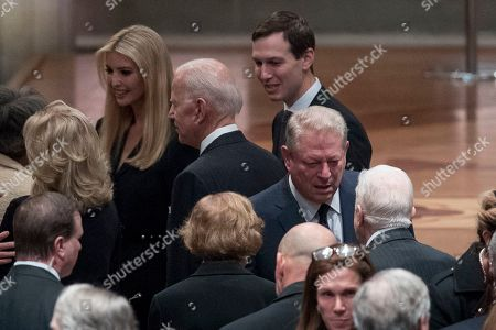 Former Vice President Joe Biden, fourth from left, and his wife Jill Biden, second from left, speak with Ivanka Trump, the daughter of President Donald Trump, third from left, and her husband, President Donald Trump's White House Senior Adviser Jared Kushner, third from right, as former Vice President Al Gore, second from right, speak to former President Jimmy Carter, right, and former first lady Rosalynn Carter, bottom center, before a State Funeral the National Cathedral.