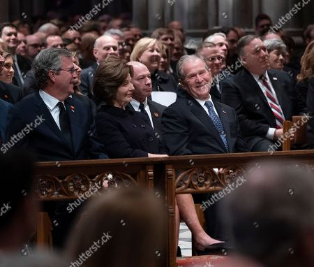Columba Bush, Jeb Bush, Laura Bush and George W. Bush attend the state funeral service at the National Cathedral.