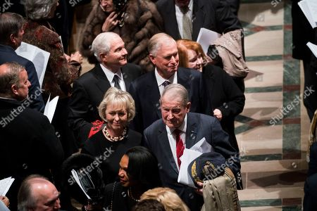 Former VP Dan Quayle, with Former CIA Director Robert Gates with Former CIA Director William Webster, Former National Security advisor Condoleezza Rice walk out behind the casket of former president George H W Bush down the center isle following a memorial ceremony at the National Cathedral