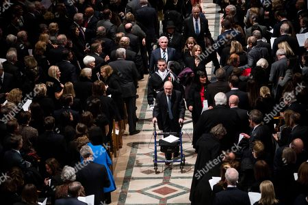 Former national security advisor Brent Scowcroft walks out behind the casket of former president George H W Bush down the center isle following a memorial ceremony at the National Cathedral
