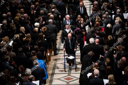 Stock Picture of Former national security advisor Brent Scowcroft walks out behind there casket of former president George H W Bush down the center isle following a memorial ceremony at the National Cathedral