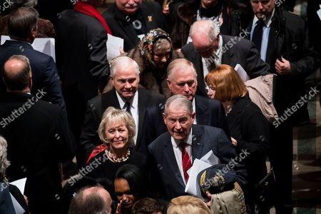 Former VP Dan Quayle, with Former CIA Director Robert Gates with Former CIA Director William Webster walk out behind the casket of former president George H W Bush down the center isle following a memorial ceremony at the National Cathedral