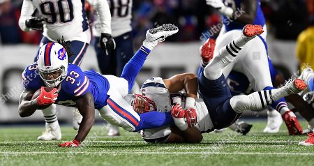 Chris Ivory, Kyle Van Noy. Buffalo Bills running back Chris Ivory, left, is tackled by New England Patriots linebacker Kyle Van Noy during the second half of an NFL football game, in Orchard Park, N.Y