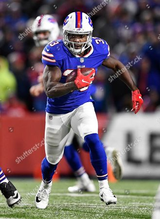 Buffalo Bills running back Chris Ivory runs with the ball during the second half of an NFL football game against the New England Patriots, in Orchard Park, N.Y